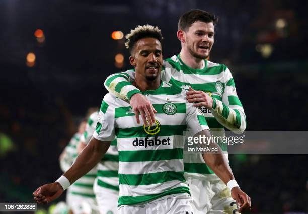 Scott Sinclair of Celtic celebrates with teammate Oliver Burke after scoring their second goal from the penalty spot during the Ladbrokes Scottish...