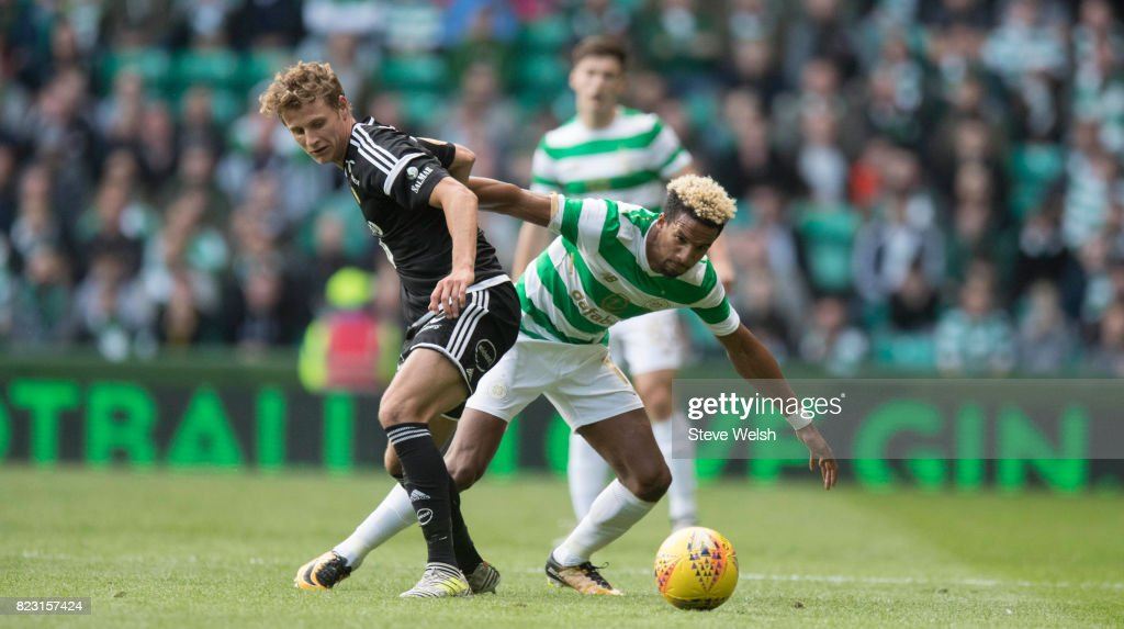 Scott Sinclair of Celtic pushes off Vegar Eggen Hedenstad of Rosenborg during the UEFA Champions League Qualifying Third Round, First Leg match between Celtic and Rosenborg at Celtic Park Stadium on July 26, 2017 in Glasgow, Scotland.