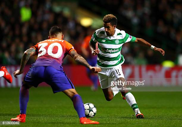 Scott Sinclair of Celtic runs with the ball under pressure form Nicolas Otamendi of Manchester City during the UEFA Champions League group C match...