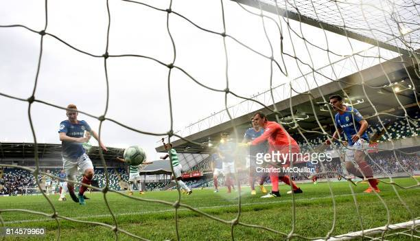 Scott Sinclair of Celtic scores during the Champions League second round first leg qualifying game between Linfield and Celtic at Windsor Park on...