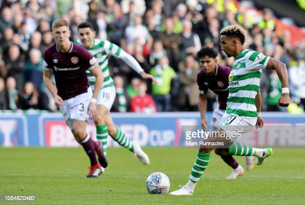 Scott Sinclair of Celtic scores his teams first goal from the penalty spot during the Betfred Scottish League Cup Semi Final between Heart of...