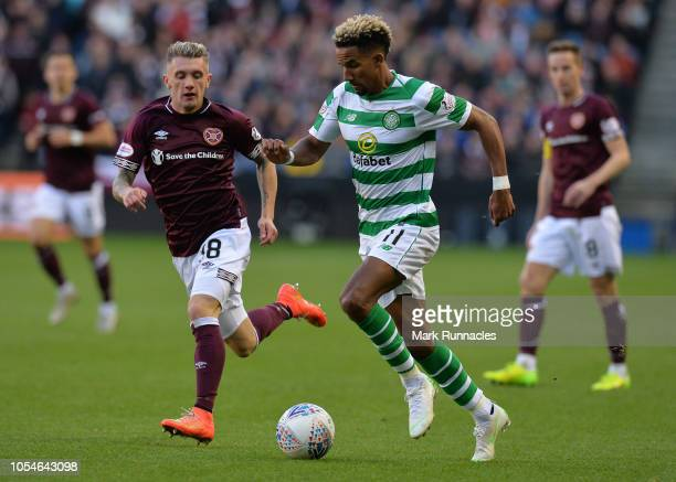 Scott Sinclair of Celtic takes on Callumn Morrison of Hearts during the Betfred Scottish League Cup Semi Final between Heart of Midlothian FC and...