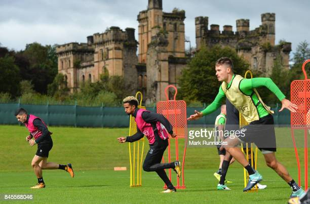 Scott Sinclair of Celtic takes part in a training drill during a Celtic training session ahead of the UEFA Champions League Group B match against...