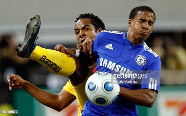 Scott Sinclair of Chelsea FC fights for possesion of the ball with Jean Beausejour of Club America during the World Football Challenge at Dallas...