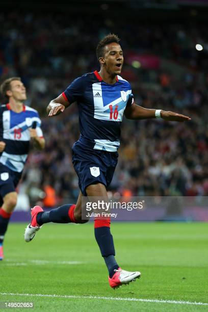 Scott Sinclair of Great Britain celebrates scoring a goal during the Men's Football first round Group A Match between Great Britain and United Arab...