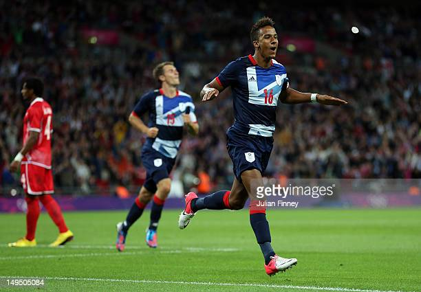 Scott Sinclair of Great Britain celebrates scoring his teams second goal during the Men's Football first round Group A Match between Great Britain...