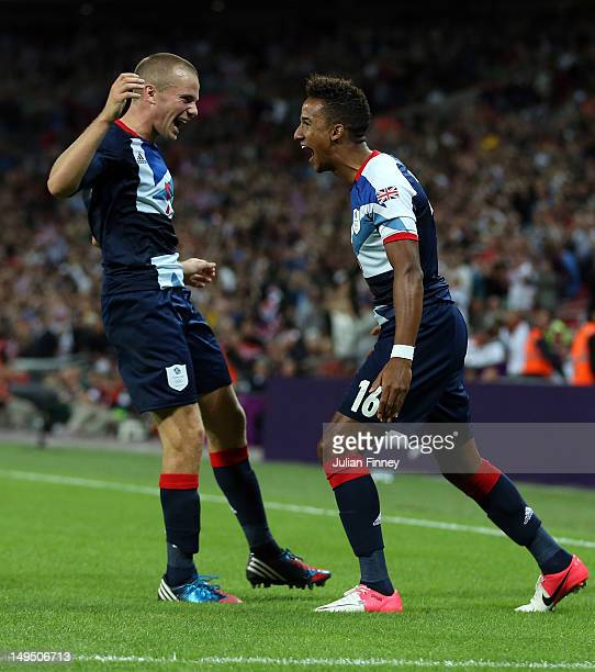 Scott Sinclair of Great Britain celebrates scoring his teams second goal with Tom Cleverley of Great Britain during the Men's Football first round...