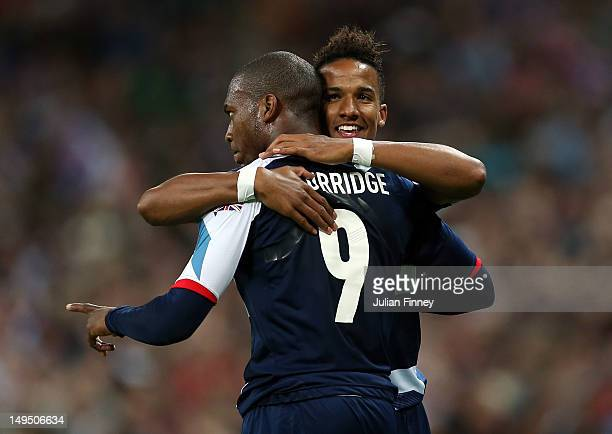 Scott Sinclair of Great Britain congratulates Daniel Sturridge of Great Britain after he scored his teams third goal during the Men's Football first...