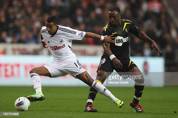 Scott Sinclair of Swansea and Nigel ReoCoker of Bolton during the Barclays Premier League match between Swansea City and Bolton Wanderers at the...