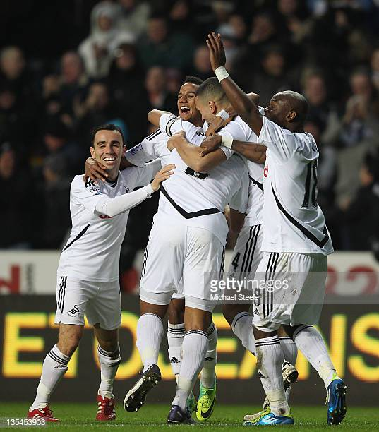 Scott Sinclair of Swansea City celebrates scoring his side first goal during the Barclays Premier League match between Swansea City and Fulham at the...