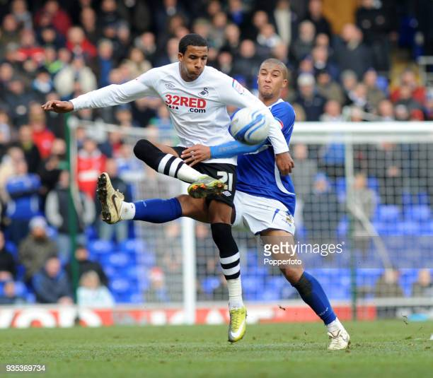 Scott Sinclair of Swansea City holds off Gianni Zuiverloon of Ipswich Town during the npower Championship match between Ipswich Town and Swansea City...