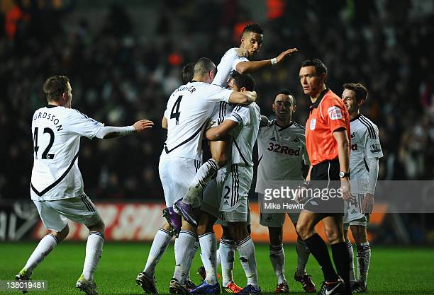 Scott Sinclair of Swansea City is held aloft after scoring the opening goal during the Barclays Premier League match between Swansea City and Chelsea...