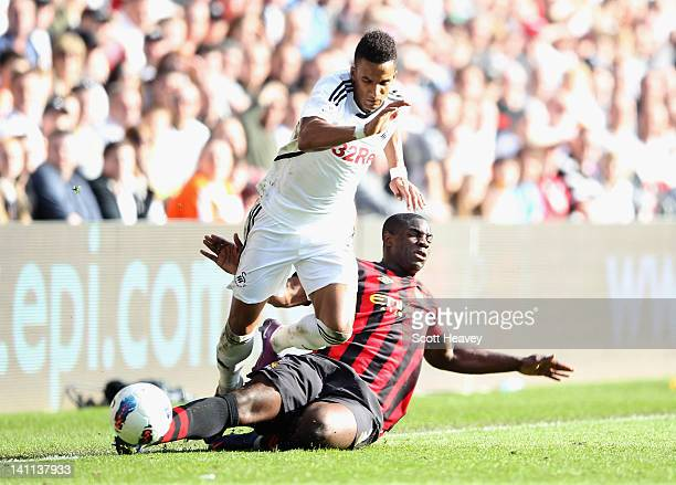 Scott Sinclair of Swansea City is tackled by Micah Richards of Manchester City during the Barclays Premier League match between Swansea City and...