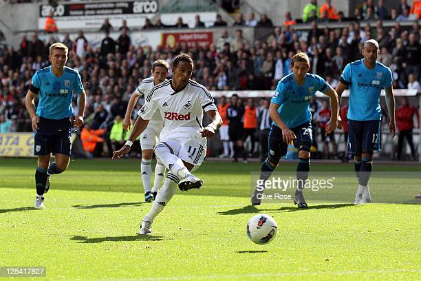Scott Sinclair of Swansea City scores from the penalty spot during the Premier League match between Swansea City and West Bromwich Albion at Liberty...