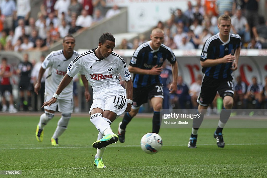 Scott Sinclair of Swansea City scores the first goal from a penalty during the Barclays Premier League match between Swansea City and Stoke City at the Liberty Stadium on October 2, 2011 in Swansea, Wales.