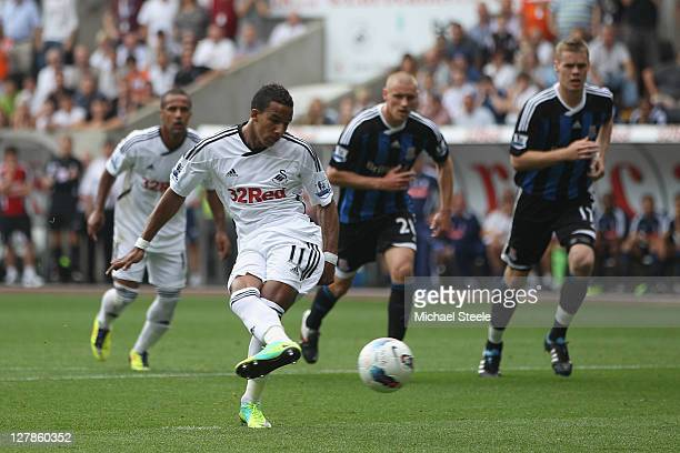 Scott Sinclair of Swansea City scores the first goal from a penalty during the Barclays Premier League match between Swansea City and Stoke City at...