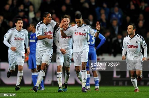 Scott Sinclair of Swansea is congratulated by teammates after scoring the opening goal during the Barclays Premier League match between Swansea City...