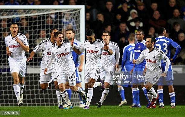Scott Sinclair Swansea is congratulated by teammates after scoring the opening goal during the Barclays Premier League match between Swansea City and...