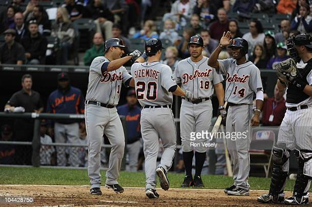 Scott Sizemore is greeted by Gerald Laird Johnny Damon and Austin Jackson of the Detroit Tigers after Sizemore hit a grand slam home run against the...