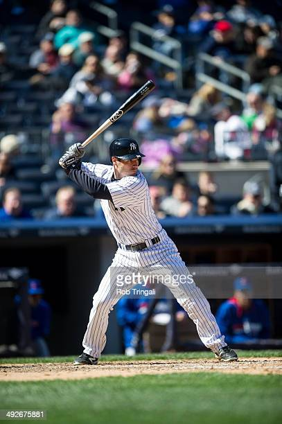 Scott Sizemore of the New York Yankees bats during the game against the Chicago Cubs at Yankee Stadium on April 16 2014 in the Bronx borough of New...