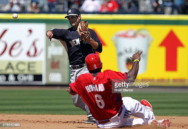 Scott Sizemore of the New York Yankees gets the out on Ryan Howard of the Philadelphia Phillies at 2nd base then turns the double play during the 3rd...