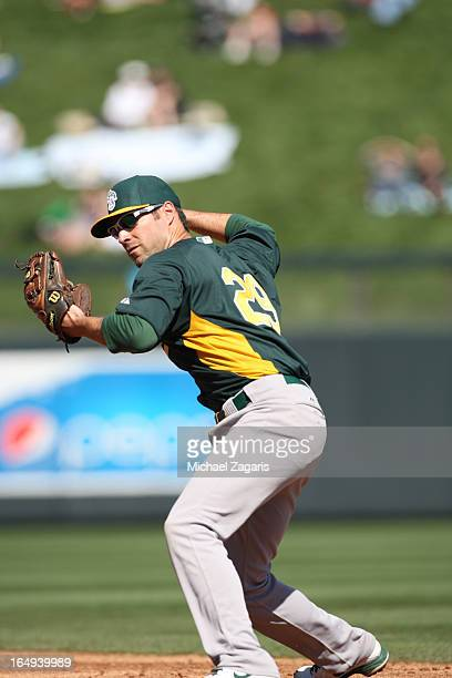 Scott Sizemore of the Oakland Athletics fields during a spring training game against the Arizona Diamondback at Salt River Fields at Talking Stick on...