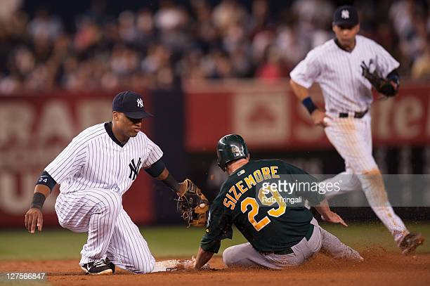 Scott Sizemore of the Oakland Athletics slides into second base during the game against the New York Yankees at Yankee Stadium on August 24 2011 in...