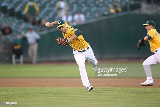 Scott Sizemore of the Oakland Athletics throws to first base against the Tampa Bay Rays at the OaklandAlameda County Coliseum on July 25 2011 in...