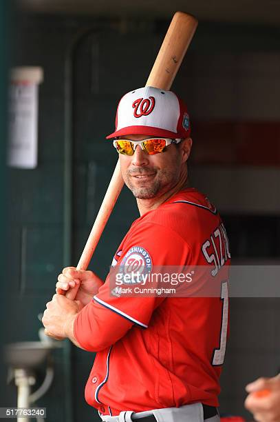 Scott Sizemore of the Washington Nationals looks on from the dugout during the Spring Training game against the Detroit Tigers at Joker Marchant...