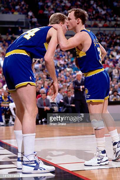 Scott Skiles and Rik Smits of the Indiana Pacers talk against the Portland Trailblazers at the Veterans Memorial Coliseum in Portland Oregon circa...