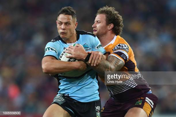 Scott Sorensen of the Sharks is tackled during the round 20 NRL match between the Brisbane Broncos and the Cronulla Sharks at Suncorp Stadium on July...