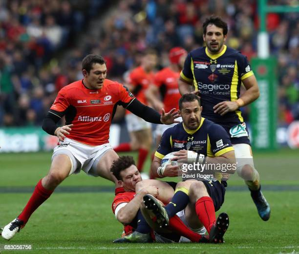 Scott Spedding of Clermont Auvergne is tackled by Duncan Taylor and Alex Goode during the European Rugby Champions Cup Final between ASM Clermont...