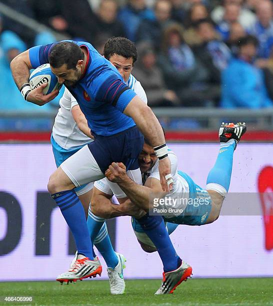 Scott Spedding of France is tackled by Andrea Masi of Italy during the RBS Six Nations match between Italy and France at Stadio Olimpico on March 15...