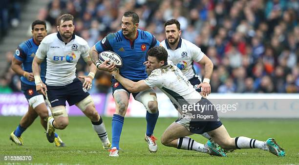 Scott Spedding of France is tackled by Duncan Taylor during the RBS Six Nations match between Scotland and France at Murrayfield Stadium on March 13...