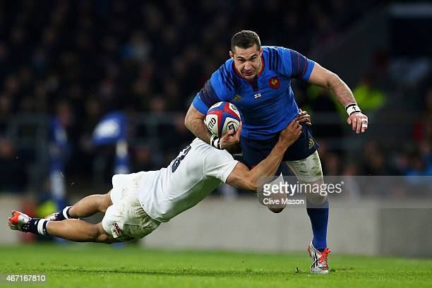 Scott Spedding of France is tackled by Jonathan Joseph of England during the RBS Six Nations match between England and France at Twickenham Stadium...
