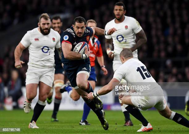 Scott Spedding of France is tackled by Mike Brown of England during the RBS Six Nations match between England and France at Twickenham Stadium on...