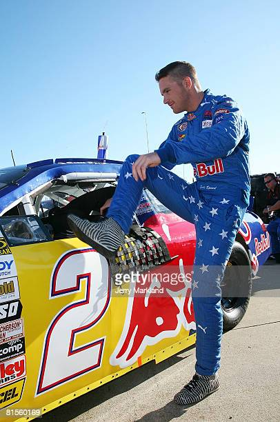 Scott Speed driver of the Red Bull Toyota gets into his car priot to the start of the ARCA RE/MAX Series Racing for Wildlife 200 at the Michigan...