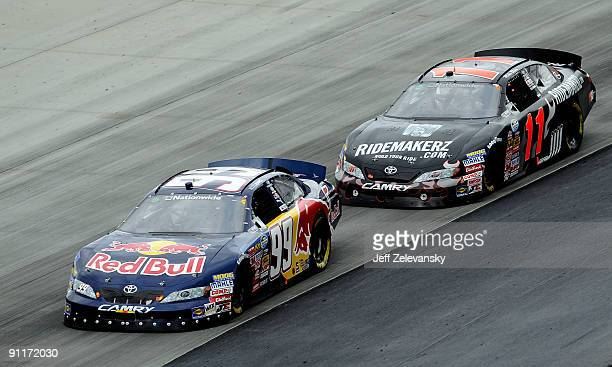 Scott Speed driver of the Red Bull Toyota leads Mike Bliss driver of the Ridemakerz Toyota during the NASCAR Nationwide Series Dover 200 at Dover...