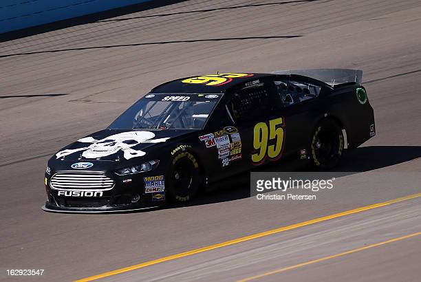 Scott Speed driver of the Surrender the Sponsor Ford drives during practice for the NASCAR Sprint Cup Series Subway Fresh Fit 500 at Phoenix...