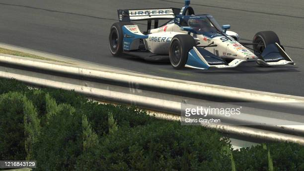 Scott Speed, driver of the US Concrete/Curb Andretti Herta Autosport Honda, races during the IndyCar iRacing Challenge Honda Indy Grand Prix of...