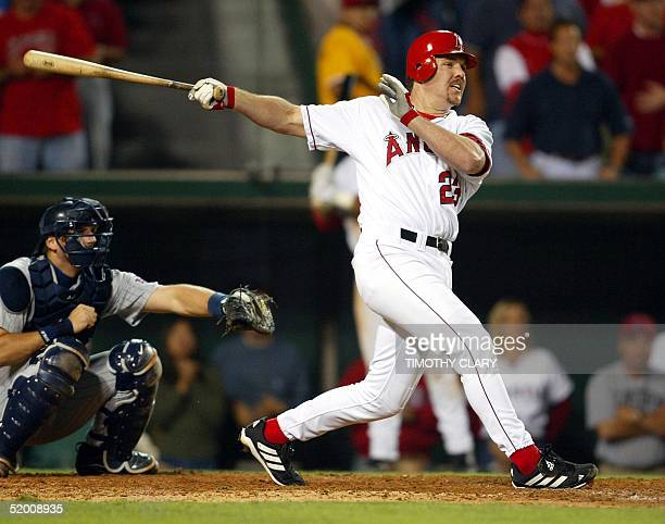 Scott Spiezio of the Anaheim Angels hits an double to score Alex Ochoa in the seventh inning against the Minnesota Twins during Game 4 of the...