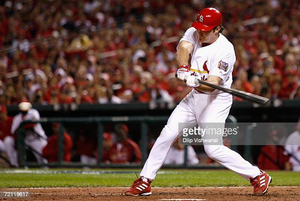 Scott Spiezio of the St. Louis Cardinals hits an RBI single against the San Diego Padres during the sixth inning of Game Four of the National League...