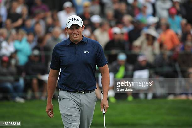 Scott Stallings celebrates on the 18th green during the final round of the Farmers Insurance Open on Torrey Pines South on January 26 2014 in La...