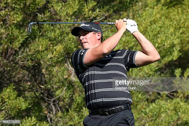 Scott Stallings hits a tee shot on the 4th hole in the first round of the Northern Trust Open at the Riviera Country Club on February 13 2014 in...