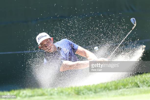 Scott Stallings hits out of the bunker on the 18th hole during the final round of A Military Tribute At The Greenbrier held at the Old White TPC...