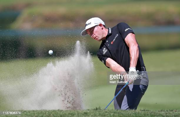 Scott Stallings of the United States plays a shot from a bunker on the third hole during the third round of the Valspar Championship on the...
