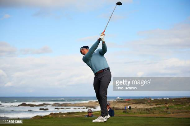 Scott Stallings of the United States plays his shot from the 13th tee during the second round of the ATT Pebble Beach ProAm at Monterey Peninsula...