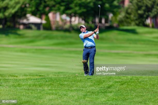 Scott Stallings plays a shot in the rough of the 18th hole during third round action of the RBC Canadian Open on July 29 at Glen Abbey Golf Club in...