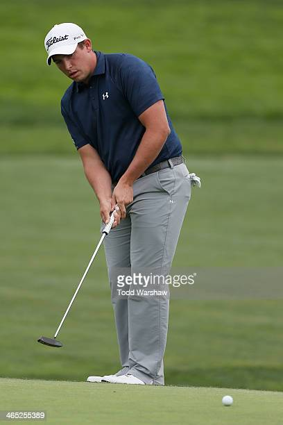 Scott Stallings putts on the 18th hole during the final round of the Farmers Insurance Open on Torrey Pines South on January 26 2014 in La Jolla...