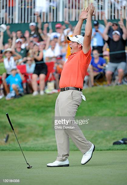 Scott Stallings reacts after making a birdie putt on the first playoff hole to win The Greenbrier Classic at The Old White TPC on July 31 2011 in...